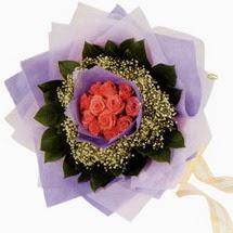 12 adet gül ve elyaflardan   Gümüşhane anneler günü çiçek yolla